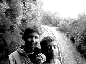 Kids on the back balcony of the Pelion Steam train, Greece, 2009